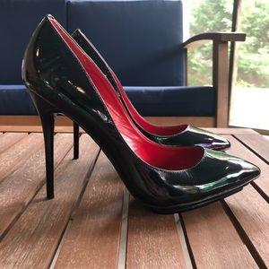 "Black patent leather 6"" stiletto pumps"